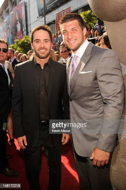 Professional racing driver Jimmie Johnson and NFL player Tim Tebow of the New York Jets arrive at the 2012 ESPY Awards at Nokia Theatre LA Live on...