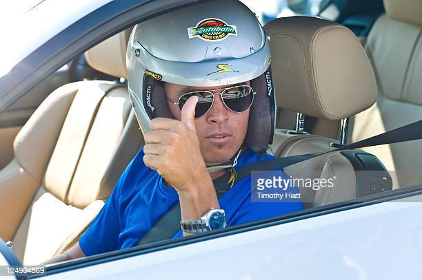 TOUR professional Rickie Fowler gives a thumbs up before taking laps at the Autobahn Racetrack in Joliet IL Fowler was joined by a group of fellow...