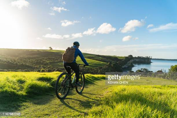 professional road cyclist on a training ride - outdoor pursuit stock pictures, royalty-free photos & images