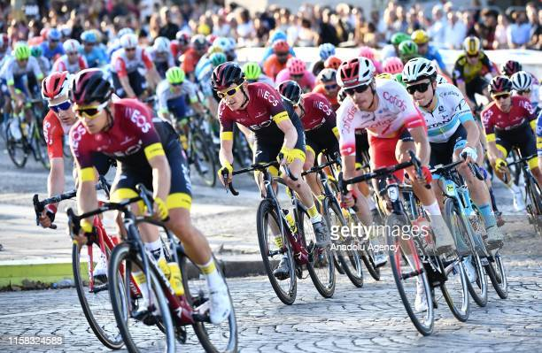 Professional road cyclists compete on the Champs-Elysees avenue during the Paris Champs-Elysees stage of the 106th edition of the Tour de France in...