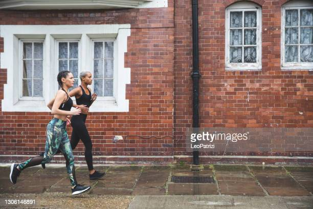 professional runners exercising in the city streets - organised group stock pictures, royalty-free photos & images