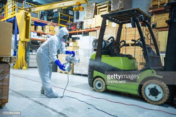 professional sanitation on warehouse miami - essential workers stock pictures, royalty-free photos & images