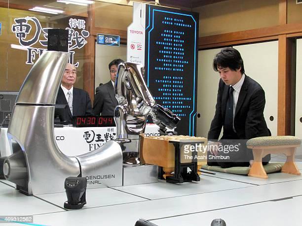 Professional shogi or Japanese chess player Chikara Akutsu competes against the Shogi soft 'Awake' in the fifth round of the 'DenOu sen Final' human...