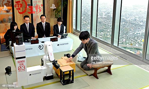 Professional shogi or Japanese chess player Masayuki Toyoshima plays against computer program 'YSS' during the third round of the 'DenOu sen' human...