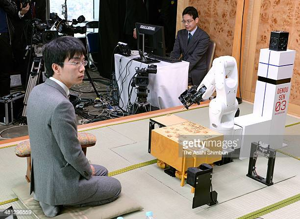 Professional shogi or Japanese chess player Masayuki Toyoshima reacts after winning against computer program 'YSS' which is developped by Hiroshi...