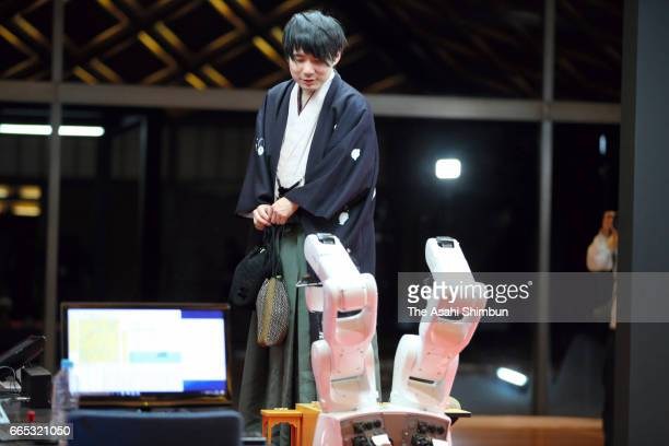 Professional Shogi player Amahiko Sato leaves after his defeat by shogi soft 'Ponanza' in the first round of the Deno Sen at Nikko Toshogu Shrine on...