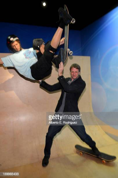 Professional skateboarder Tony Hawk poses next to a wax figure of himself as he attends Relativity Media's Movie 43 Los Angeles Premiere After Party...