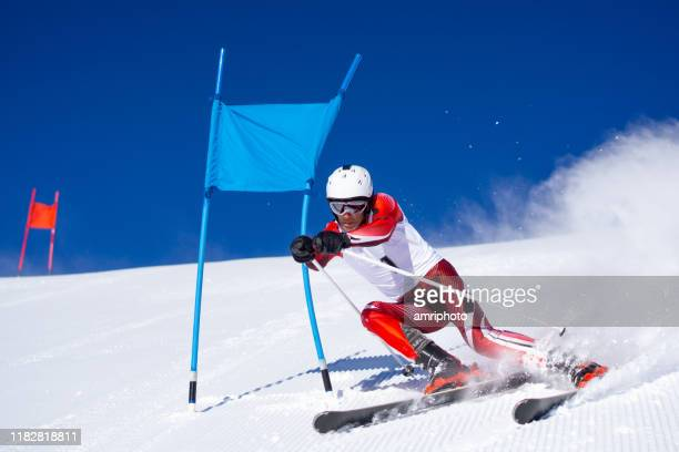professional skier during super g - skiing stock pictures, royalty-free photos & images