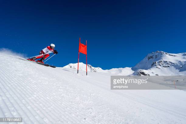 professional skier during super g skiing race - ski racing stock pictures, royalty-free photos & images