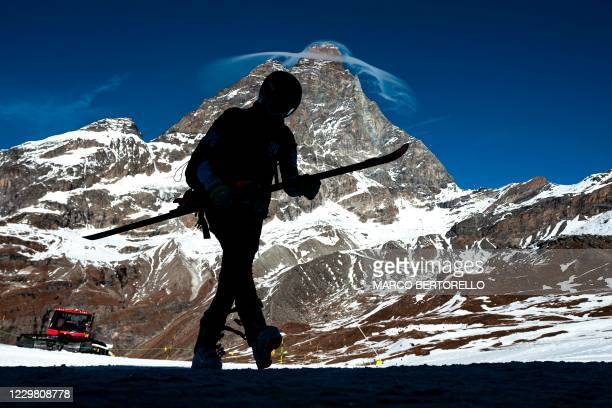 Professional skier is silhouetted against the Matterhorn summit in the alpine ski resort of Breuil-Cervinia, Northwestern Italy, on November 25,...