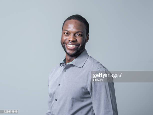 professional smiling over gray background - formal portrait stock pictures, royalty-free photos & images