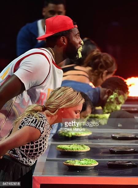 Professional snowboarder Jamie Anderson NBA player Andre Drummond jockey Victor Espinoza and NFL player Emmanuel Sanders participate in a key slime...