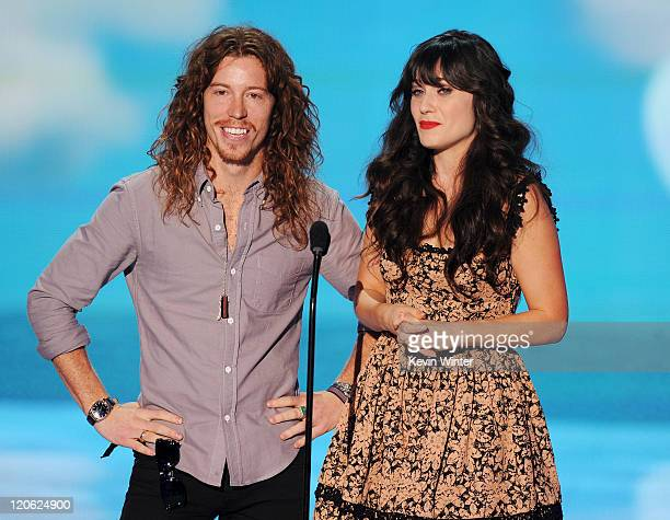 Professional snowboarder Shaun White and actress Zooey Deschanel speak onstage during the 2011 Teen Choice Awards held at the Gibson Amphitheatre on...