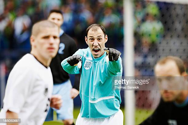 professional soccer goalkeeper directing defense - corner kick stock pictures, royalty-free photos & images