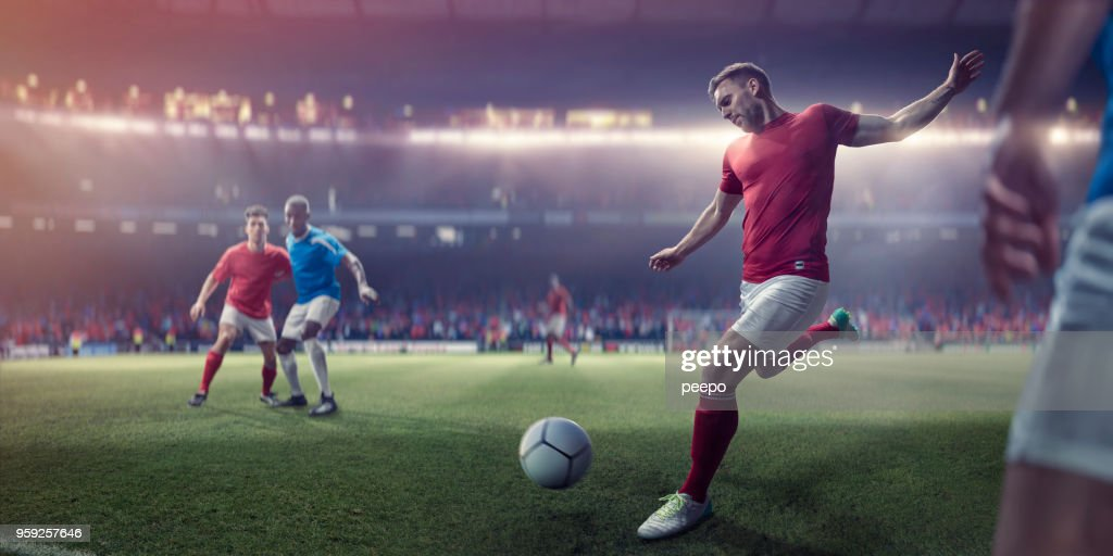 Professional Soccer Player About To Kick Football During Soccer Match : Stock Photo