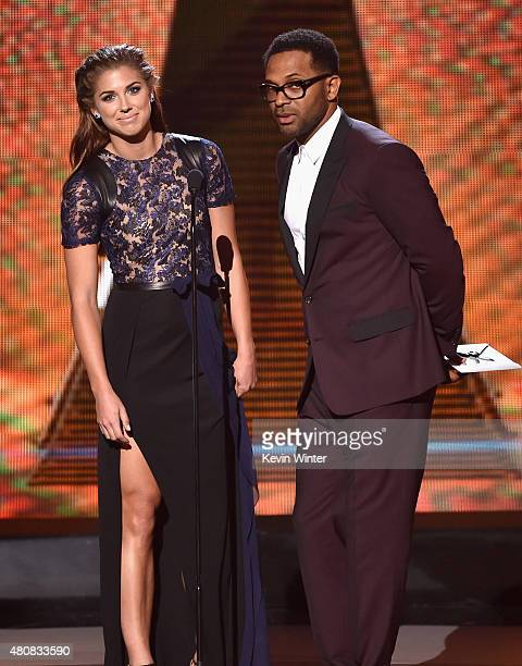 Professional soccer player Alex Morgan and actor Mike Epps speak onstage during The 2015 ESPYS at Microsoft Theater on July 15 2015 in Los Angeles...