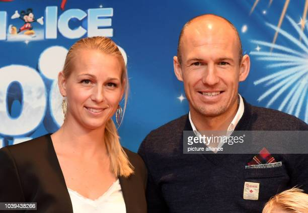 Professional soccer player Arjen Robben and his wife Bernadien arriving for the premiere of the ice skating show 'Disney on Ice' in Munich Germany 20...