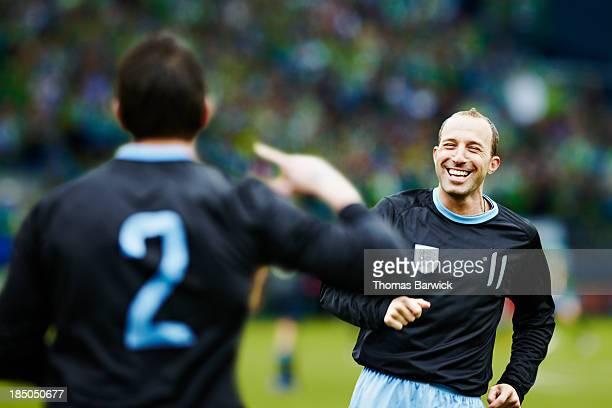 Professional soccer player celebrating in stadium