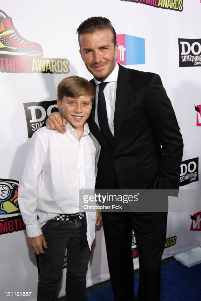 Professional soccer player David Beckham and his son Brooklyn Beckham arrive at the 2011 VH1 Do Something Awards at the Hollywood Palladium on August...