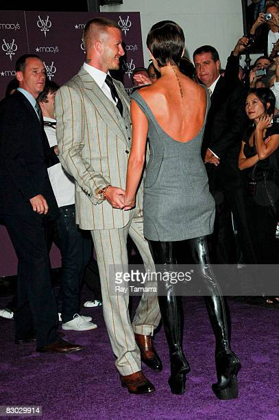 Professional soccer player David Beckham and singer Victoria Beckham attend the launch of the Beckham Signature fragrance collection at Macy's on...