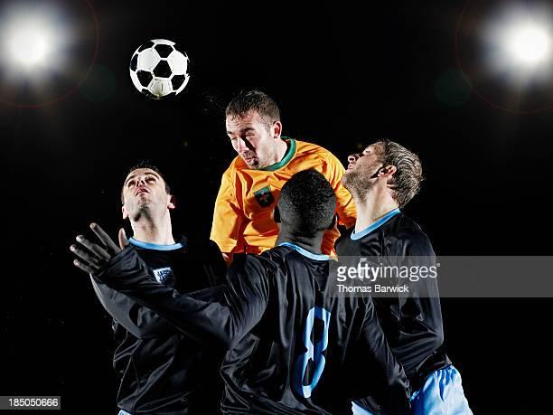 professional soccer player heading ball - ヘディングをする ストックフォトと画像