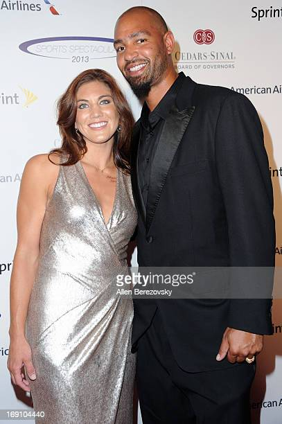 Professional soccer player Hope Solo and NFL player Jerramy Stevens arrive at the Sports Spectacular 28th Anniversary Gala at the Hyatt Regency...