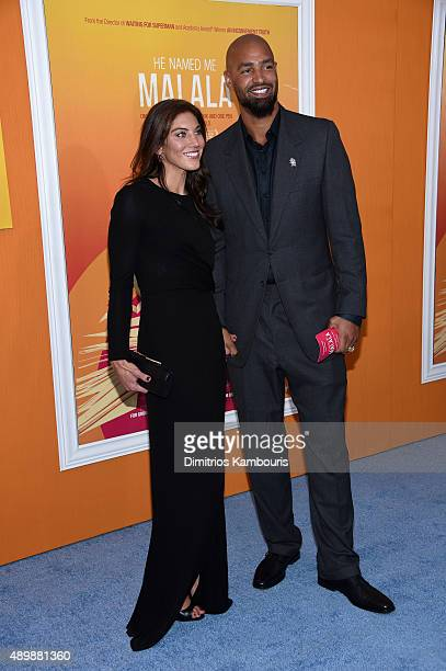 """Professional soccer player Hope Solo and professional football player Jerramy Stevens attend the """"He Named Me Malala"""" New York premiere at Ziegfeld..."""