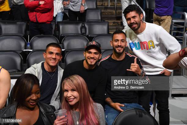 Professional Soccer Players Luis Reyes Henry Martin and Oribe Peralta attend a game between the Brooklyn Nets and the Los Angeles Lakers on March 22...