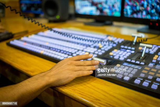 professional sound and video engineer working in digital recording, broadcasting, editing tv studio - post-production stock pictures, royalty-free photos & images