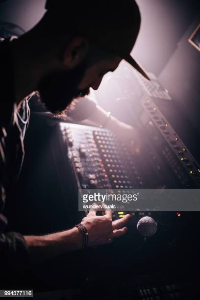 professional sound engineer working on sound mixer control panel - producer stock pictures, royalty-free photos & images