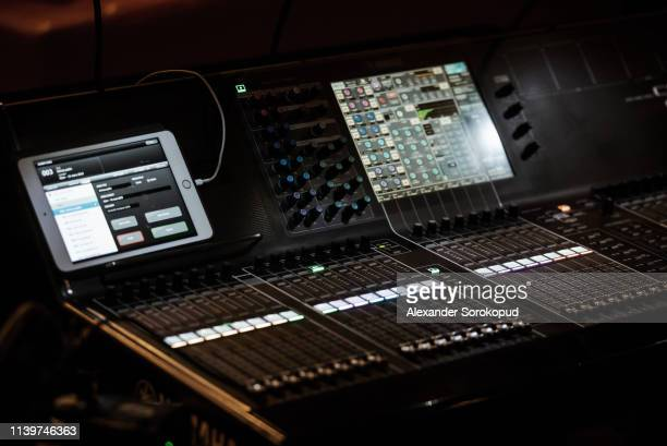 professional sound equipment highlighted in darkness before the concert - メディア機材 ストックフォトと画像