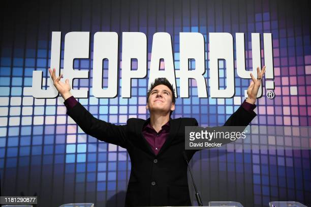 Professional sports gambler and former Jeopardy champion James Holzhauer poses at the IGT booth during the trade show debut of two Jeopardythemed IGT...