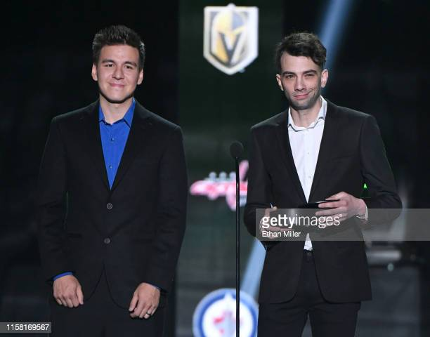 Professional sports gambler and Jeopardy champion James Holzhauer and and actor Jay Baruchel present the Frank J Selke Trophy during the 2019 NHL...