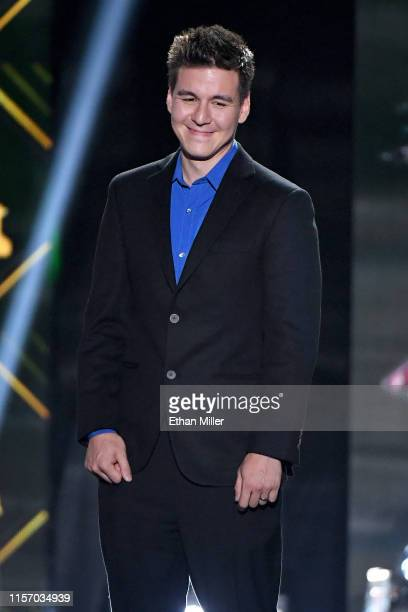 Professional sports gambler and Jeopardy champion James Holzhauer presents the Frank J Selke Trophy during the 2019 NHL Awards at the Mandalay Bay...