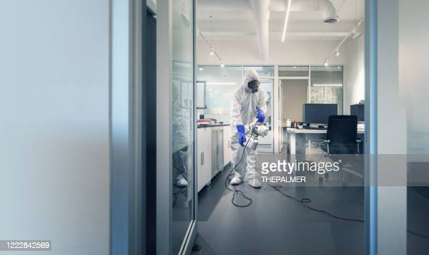 professional spray and sanitation of a corporate office - clorox stock pictures, royalty-free photos & images