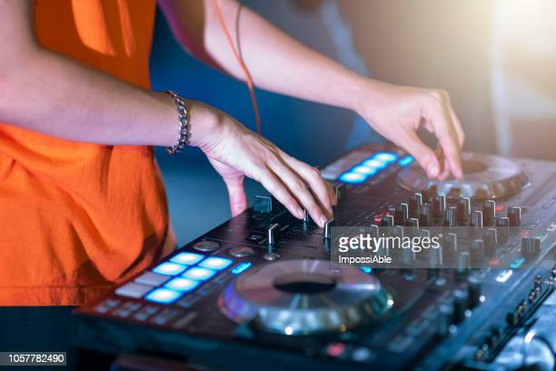 professional stage sound mixer closeup at sound engineer hand using audio mix slider working during concert performance - impossiable stock pictures, royalty-free photos & images