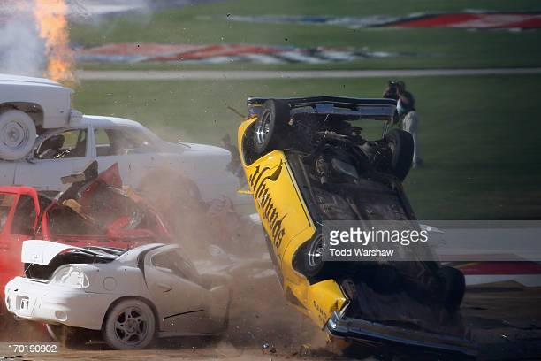 Professional Stuntman Spanky Spangler Jr flips his car after crashing into a pyramid of cars during the Wild Asphalt Circus Ultimate Daredevil Jump...