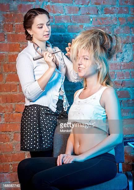 professional stylist at work - backcombed stock photos and pictures
