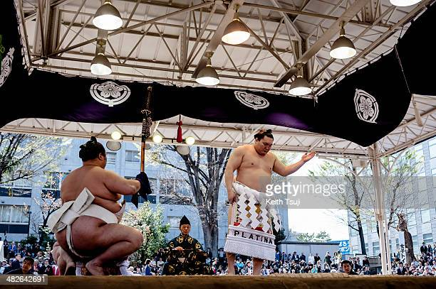Professional sumo wrestler Hakuho Sho performs Dohyoiri the ringentering ceremony during the Ceremonial Sumo Tournament or Honozumo at the Yasukuni...