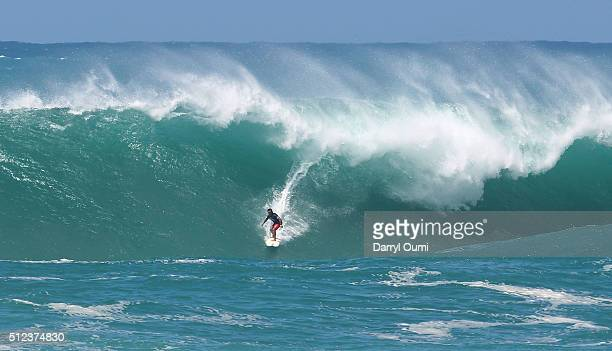 Professional surfer Aaron Gold drops in on a wave at The Quiksilver in Memory of Eddie Aikauat Waimea Bay on February 25 2016 in Waimea Hawaii