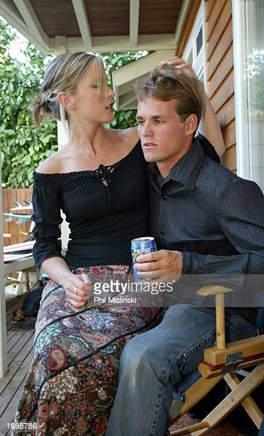 Professional surfer Damien Hobgood hangs with his girlfriend Charlotte during filming for the WB's reality television show North Shore December 19...