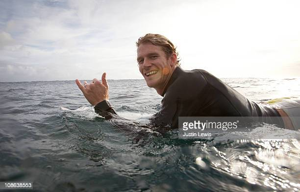 Professional surfer doing a shaka.