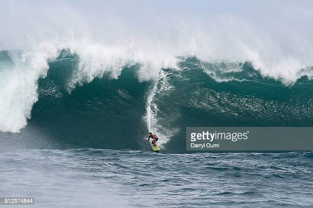 Professional surfer John John Florence makes the drop in a wave at Waimea Bay on February 25 2016 in Waimea Hawaii