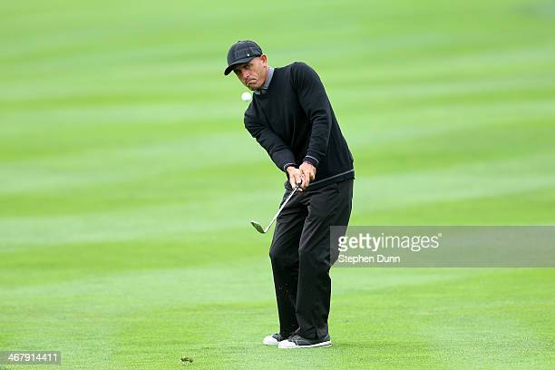 Professional surfer Kelly Slater chips to the first hole green during the third round of the ATT Pebble Beach National ProAm at the Pebble Beach Golf...