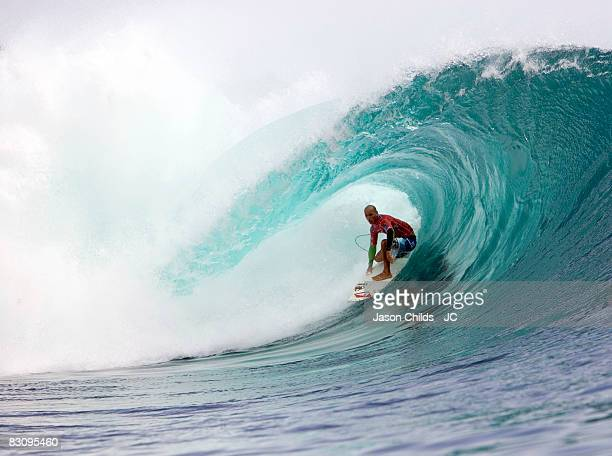 Professional surfer Kelly Slater of the US rides the tube while surfing in the first round of the 2008 Rip Curl Pro Search July 2008 in Bali Indonesia