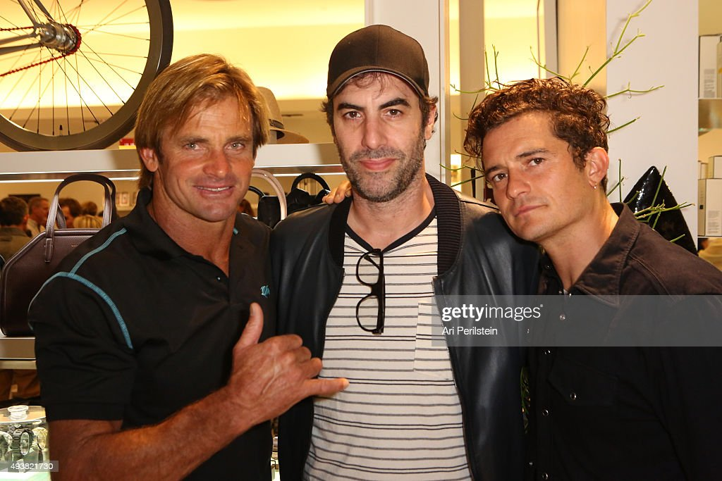 Professional surfer Laird Hamilton, actor Sacha Baron Cohen, and actor Orlando Bloom attend the launch of Laird Apparel by Laird Hamilton at Ron Robinson on October 22, 2015 in Santa Monica, California.
