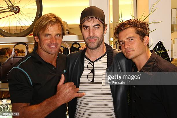Professional surfer Laird Hamilton, actor Sacha Baron Cohen, and actor Orlando Bloom attend the launch of Laird Apparel by Laird Hamilton at Ron...