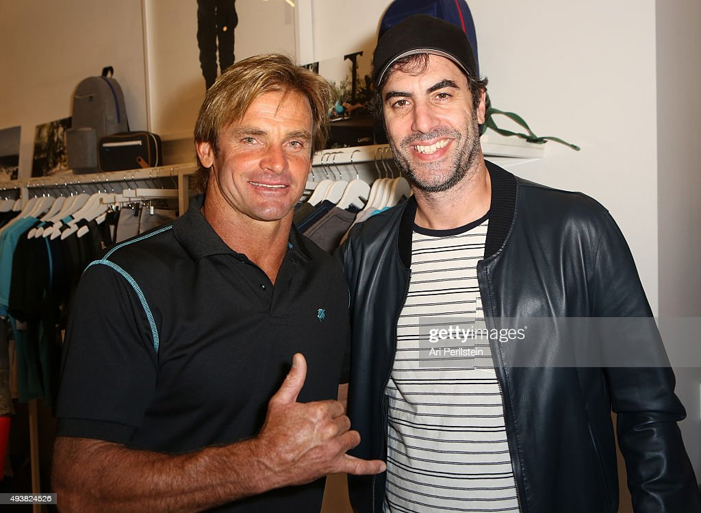 Professional surfer Laird Hamilton (L) and actor Sacha Baron Cohen attend the launch of Laird Apparel by Laird Hamilton at Ron Robinson on October 22, 2015 in Santa Monica, California.