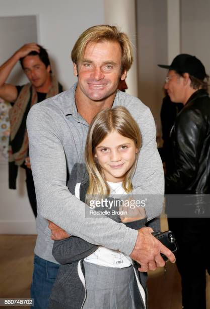Professional surfer Laird Hamilton and daughter Brody Jo Hamilton attend the Michael Muller and Sage Vaughn exhibit presented by Untitled Projects...