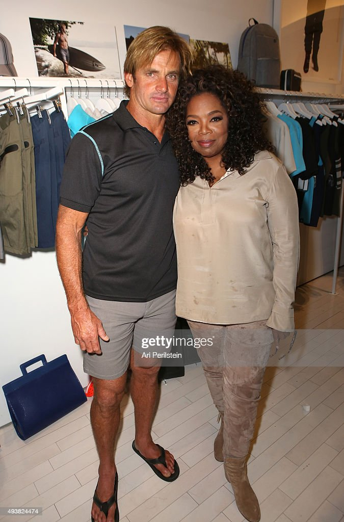 Professional surfer Laird Hamilton (L) and Oprah Winfrey attend the launch of Laird Apparel by Laird Hamilton at Ron Robinson on October 22, 2015 in Santa Monica, California.